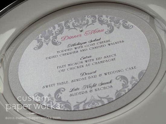 Silver, white and pink circular wedding meus with damask artwork.