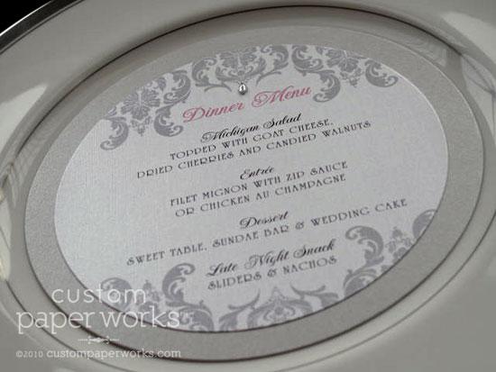 Silver, white and pink circular wedding meus with damask artwork.