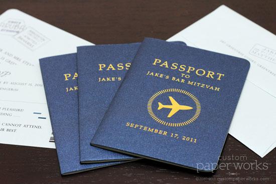 Passport mitzvah invitation with gold airplane emblem