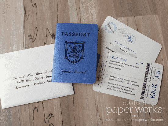 Blue and ivory passport invitation for Scotland wedding features a family crest.