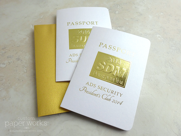 Gold and white corporate employee awards passport invitation with gold emblem