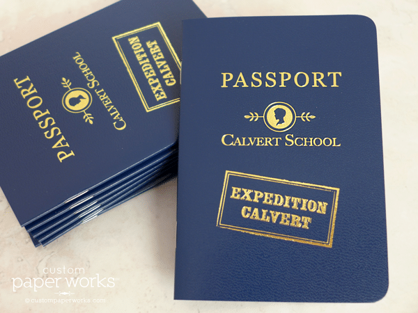 Navy blue passport booklet created for elementary school geography program