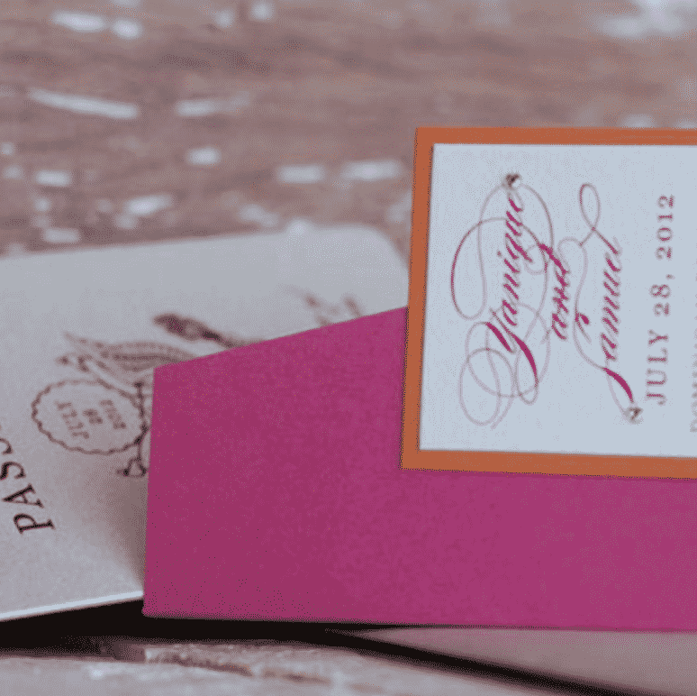 Bright pink and orange passport wedding invitation