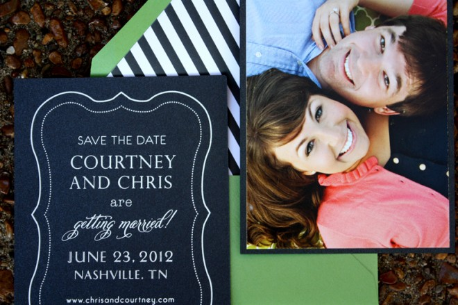 Save the date printed on black paper with green envelopes lined with black and white stripes