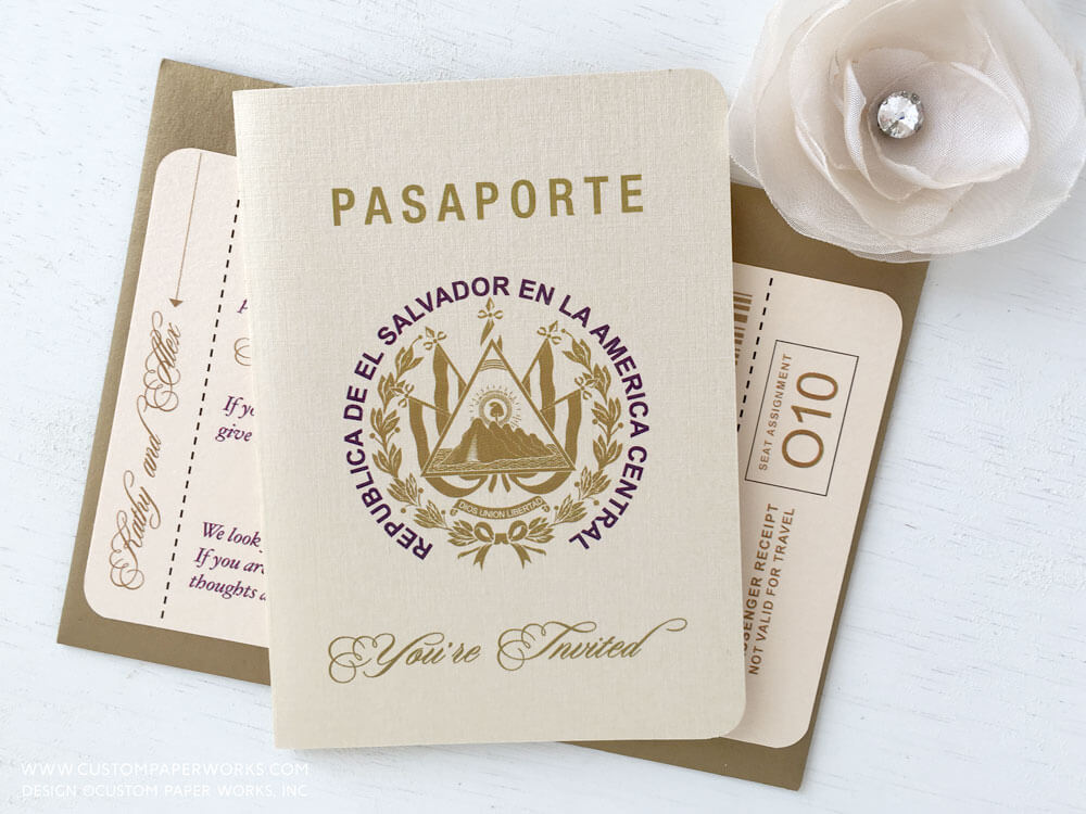 Gold and ivory passport wedding invite with El Salvador coat of arms on the cover