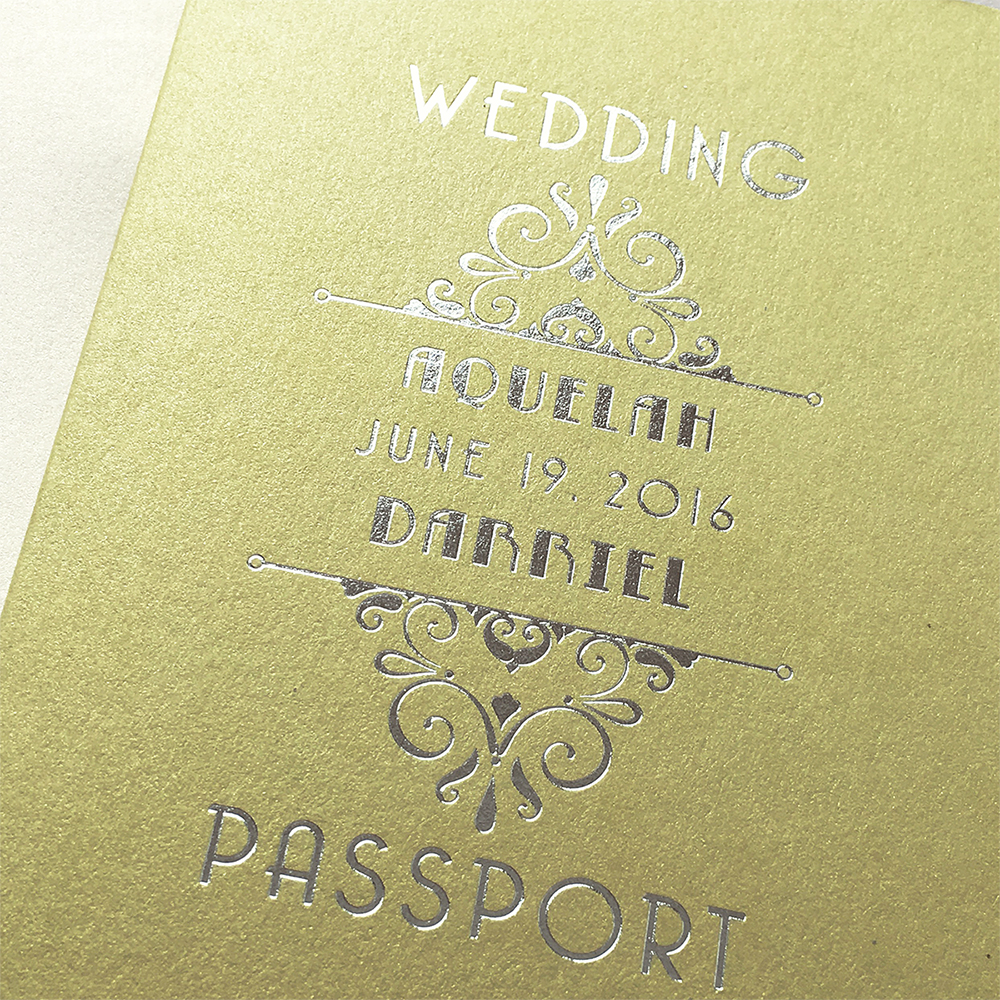 Close-up photo of an art deco style passport invitation cover in lime green with silver foil stamping