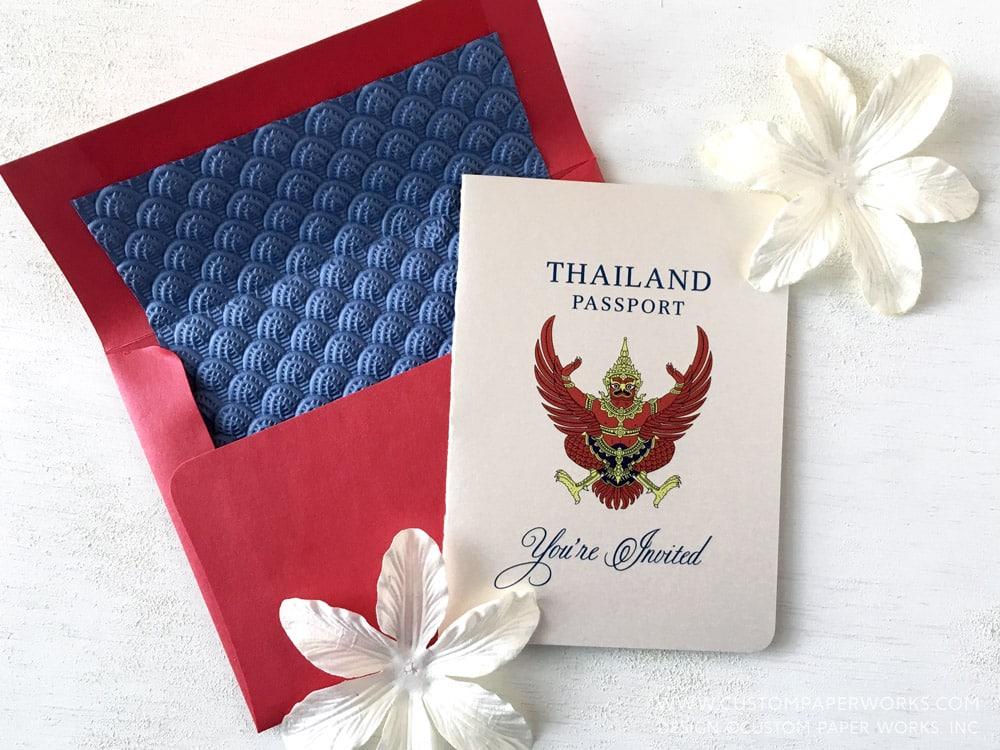 Ivory, red and blue Thailand passport wedding invitation.