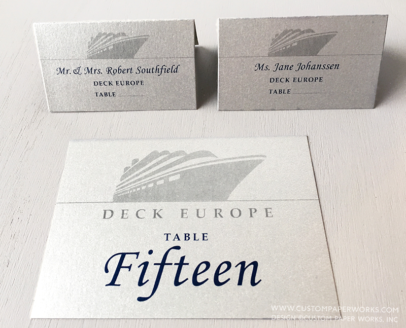 Table number and guest place cards with a cruise ship design.