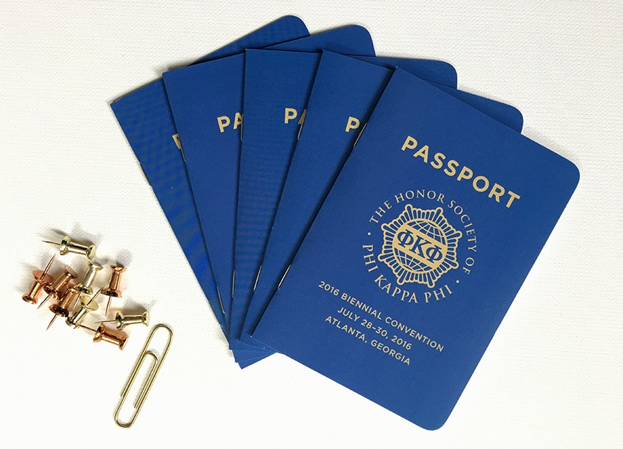 An event program that resembles a passport booklet for Phi Kappa Phi honor society, from custompaperworks.com