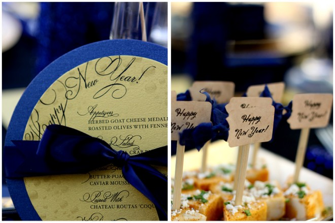 Blue and gold circular menus and appetizer skewer labels